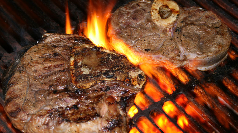 2 Steaks on a roaring fire