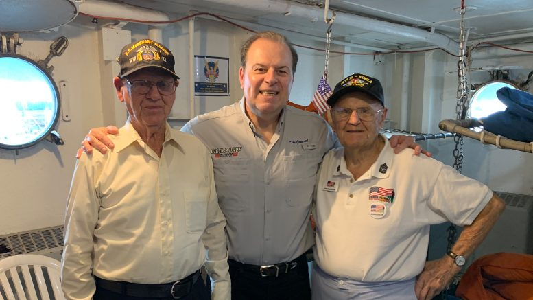 Cigar Dave with World War II veterans Jim Powell and O'Neil Ducharme aboard the American Victory Ship in Tampa, FL